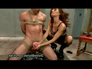 Guy in suspension bondage caned by babe
