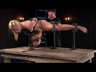 Sexy blonde anal fingered in device bondage