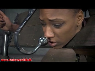 Restrained ebony sub whipped while restrained