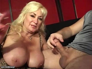 Busty mom gives a hot blowjob and smokes cigarette